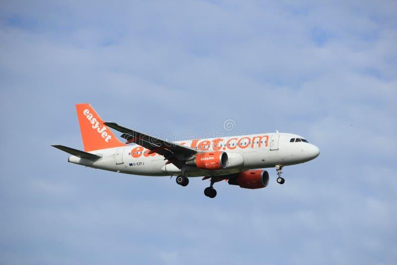 Amsterdam, the Netherlands, July, 15th 2016: G-EZFJ easyJet Airbus A319. Amsterdam, the Netherlands - July 15th 2016: G-EZFJ easyJet Airbus A319 approaching stock images