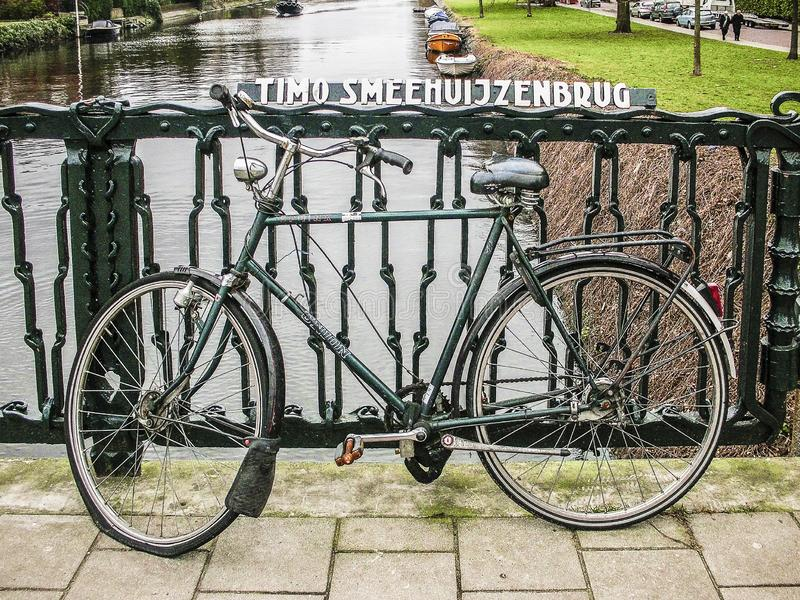 AMSTERDAM, THE NETHERLANDS - JUNE 16, 2019, bicycle on a bridge stock images