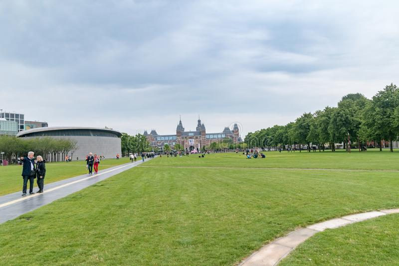 Amsterdam, Netherlands - June 7, 2019: Museumplein Square with the Van Gogh Museum and Rijksmuseum. Amsterdam, Netherlands - June 7, 2019: Museumplein. Square stock photos