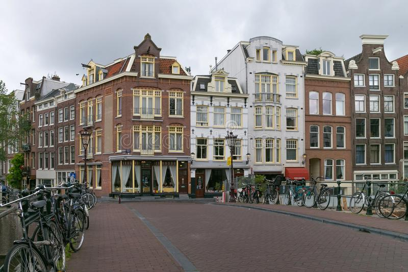 AMSTERDAM, NETHERLANDS - JUNE 25, 2017: Old buildings on the Prinsengracht street. Old buildings on the Prinsengracht street in the historical part of Amsterdam royalty free stock photo