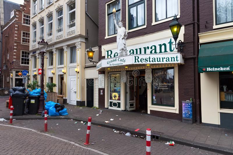 AMSTERDAM, NETHERLANDS - JUNE 25, 2017: Uncleaned garbage on the one of the central Amsterdam street. stock image
