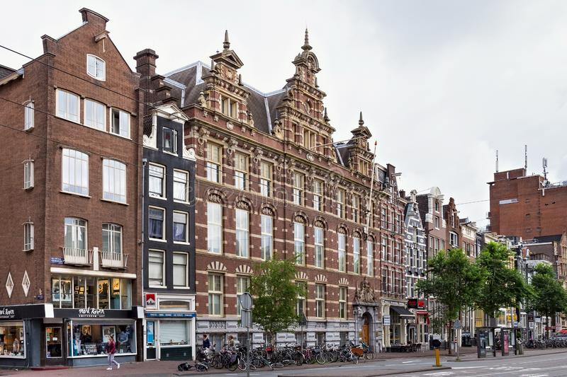 AMSTERDAM, NETHERLANDS - JUNE 25, 2017: View of the hotel Mevlana and historical buildings. View of the hotel Mevlana and historical buildings on the Nieuwezijds stock photography