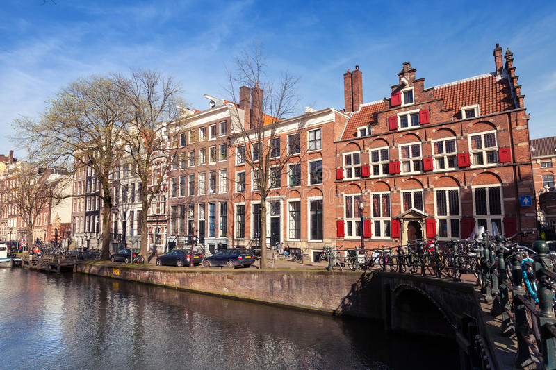 AMSTERDAM, NETHERLANDS - MARCH 19, 2014: Colorful houses along t royalty free stock photos
