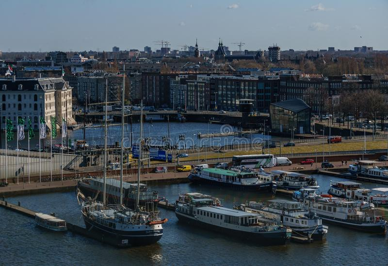 AMSTERDAM, NETHERLANDS - March 20, 2018 : View from the height of the narrow houses of Amsterdam. stock images