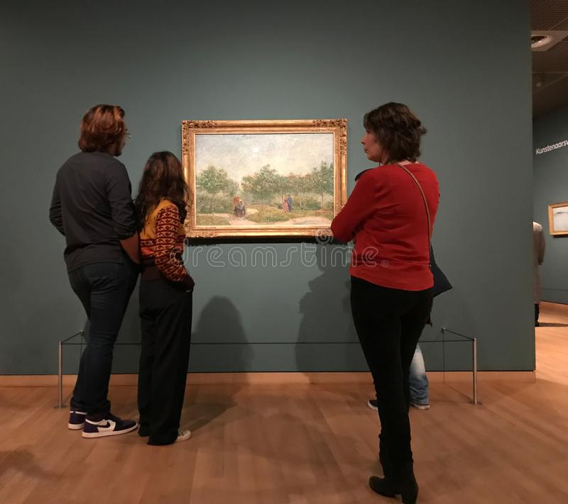 AMSTERDAM, NETHERLANDS - MARCH 19, 2019: Visitors looks at the paintings by Vincent van Gogh in Museum Van Gogh in Amsterdam, stock photos