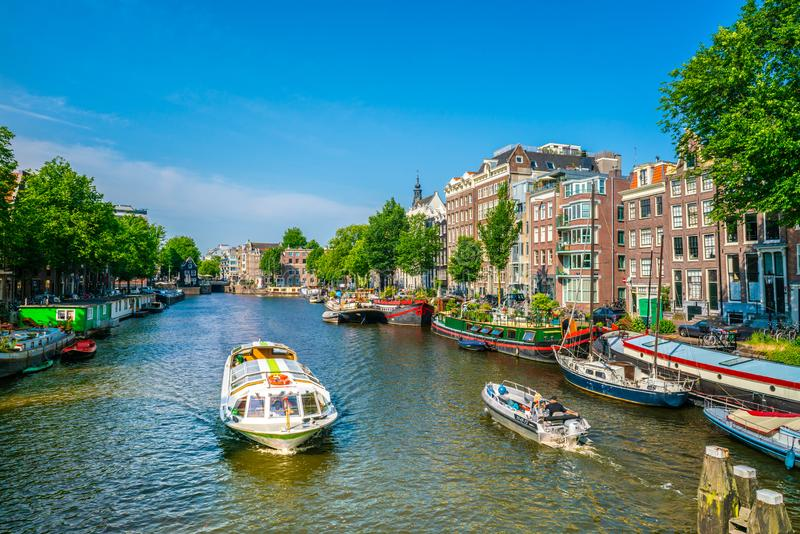 Canal cruise boat in Amsterdam royalty free stock photo