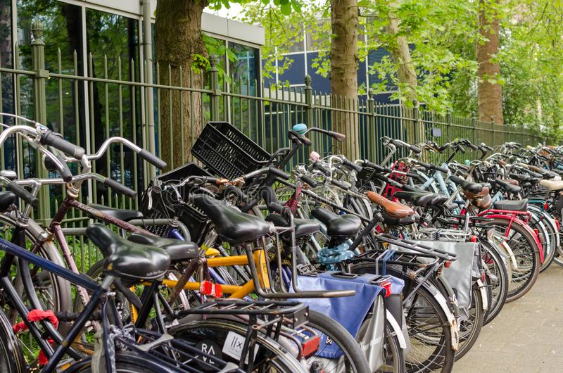 Amsterdam, Netherlands - May 03 2019: A lot of bicycles in line on the bike parking royalty free stock photography