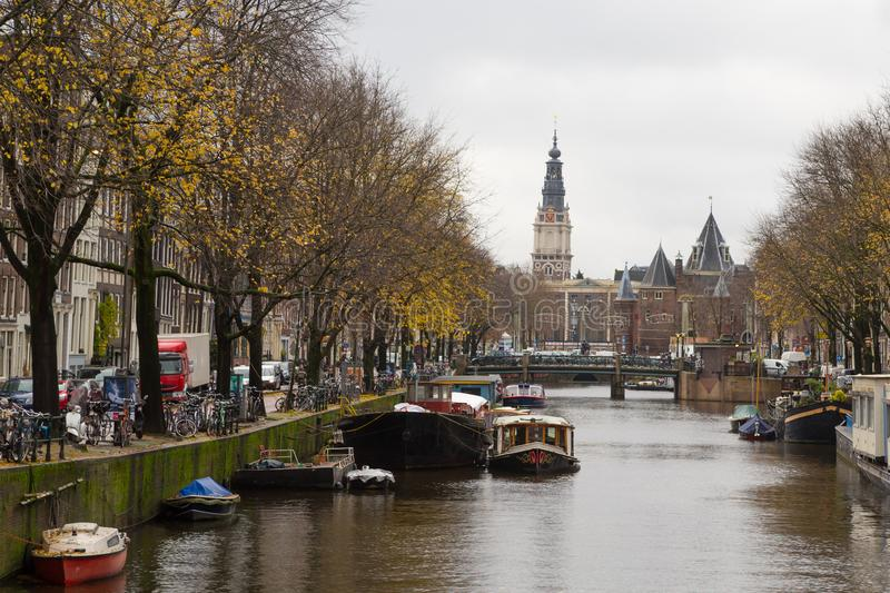 Amsterdam, Netherlands - November 28, 2019: Canal view of the de waag weight house in amsterdam city in autumn stock images