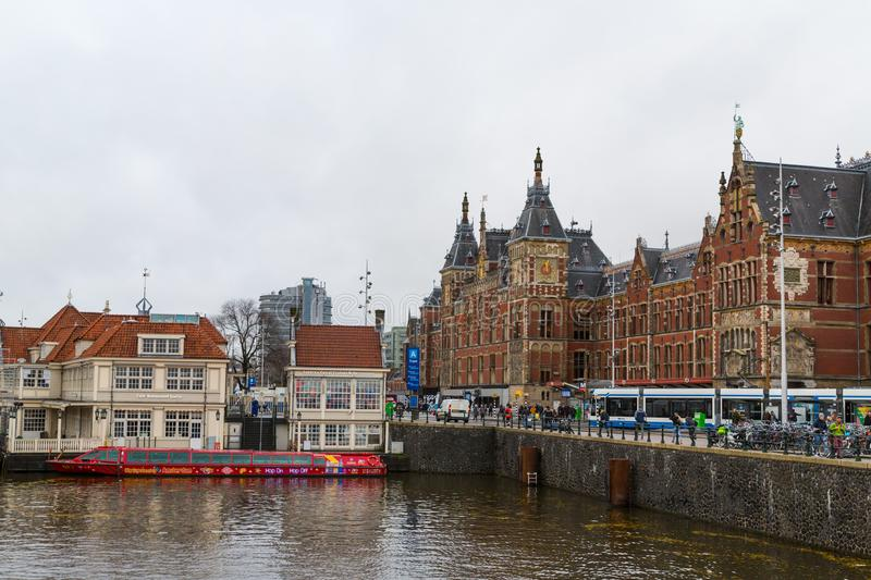 Amsterdam, Netherlands - November 28, 2019: Amsterdam Central station. Many bicycles parked in front of the Central station. Tourist boats royalty free stock photos