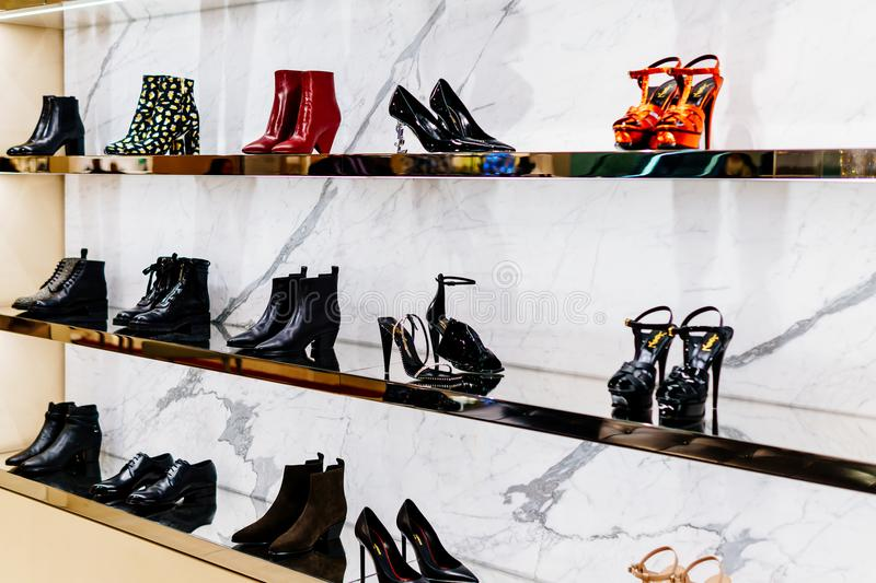 Wide Selection Of Women Shoes In Shopping Mall Store Inside. AMSTERDAM, NETHERLANDS - NOVEMBER 14, 2017: Wide Selection Of Women Shoes In Shopping Mall Store stock photography