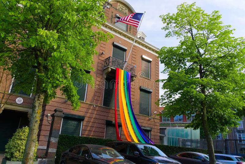27-07-2019 amsterdam the netherlands pride parade 2019 american embassy hanging out the pride flag royalty free stock photography