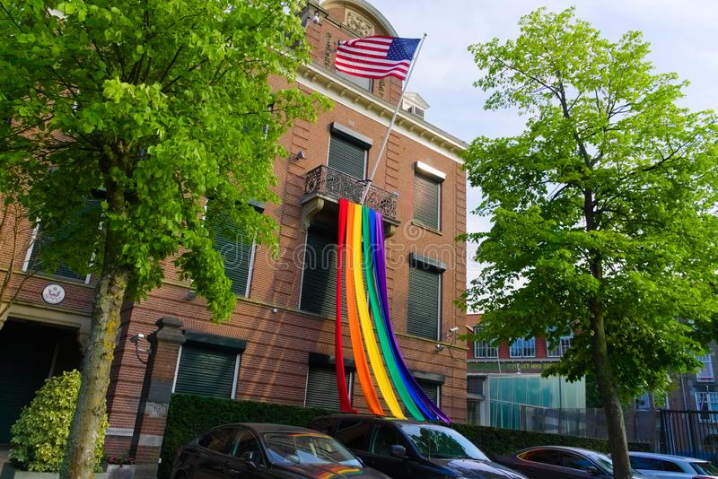 27-07-2019 amsterdam the netherlands pride parade 2019 american embassy hanging out the pride flag stock images