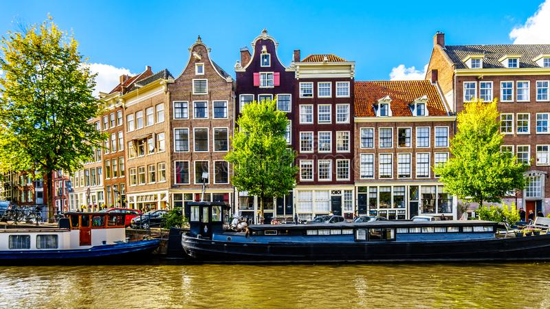 The Prinsengracht Prince Canal at the Leliegracht Lelie Canal with its many historic houses in the center of Amsterdam. Amsterdam, the Netherlands - Sept 28 royalty free stock photo