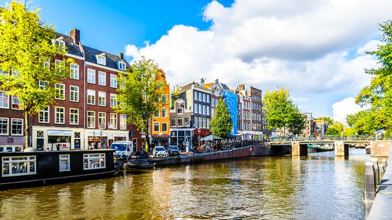 The Prinsengracht Prince Canal at the Leliegracht Lelie Canal with its many historic houses in the center of Amsterdam. Amsterdam, the Netherlands - Sept 28 royalty free stock images