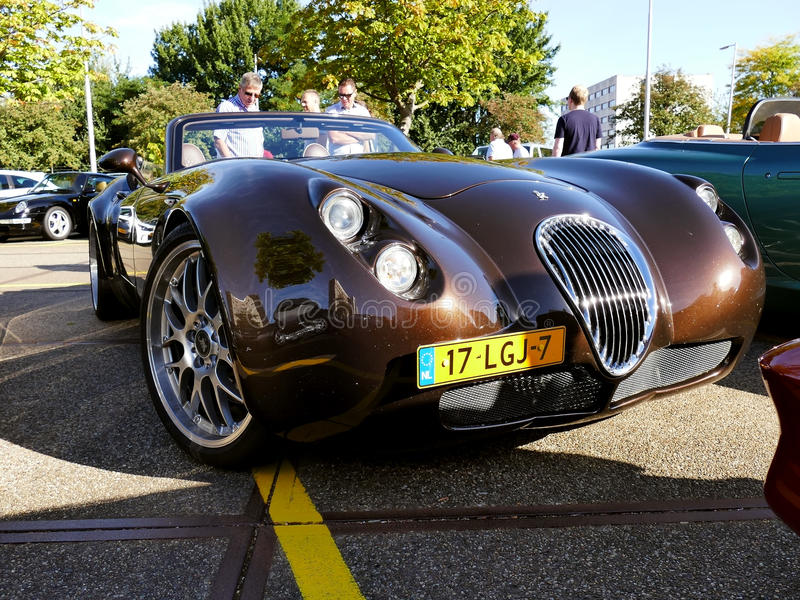 Amsterdam, The Netherlands - September 10, 2016: Brown Wiesmann Roadster mf4-s uit 2010. On display during Cars & Coffee XXL show. Non-ticketed public event royalty free stock photography