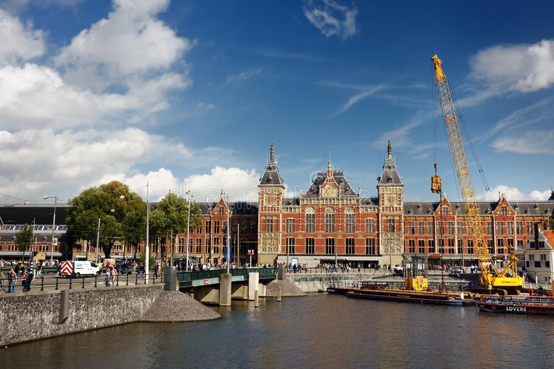 AMSTERDAM, NETHERLANDS - SEPTEMBER 17, 2018: Amsterdam Central Train Station at sunny summer day, the Netherlands royalty free stock images