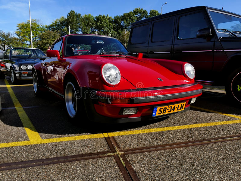 Amsterdam, The Netherlands - September 10, 2016: Red Porsche 911 Turbo 1983. On display during Cars & Coffee XXL show. Non-ticketed public event held in the royalty free stock photography