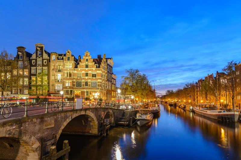 Amsterdam Netherlands sunset city skyline at canal stock image