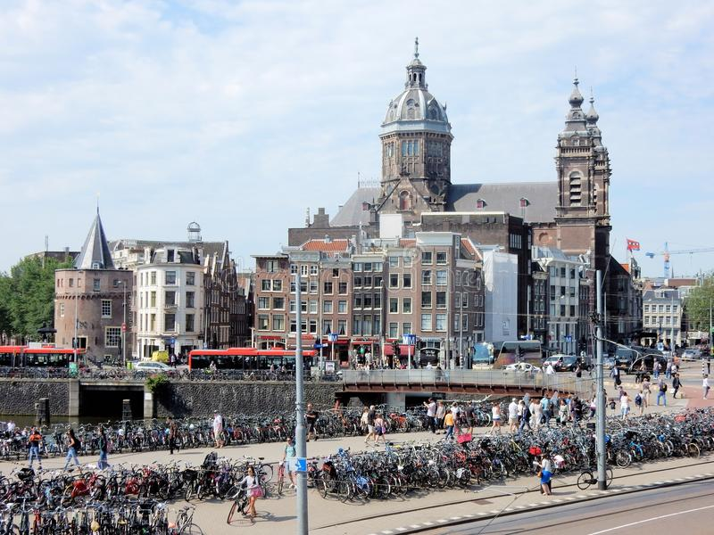 Amsterdam with Nicolaas basilica , Schreierstoren, bicycle. Amsterdam city center, Prins Hendrikkade with monuments basilica church H. Nicolaas, Schreierstoren stock photo