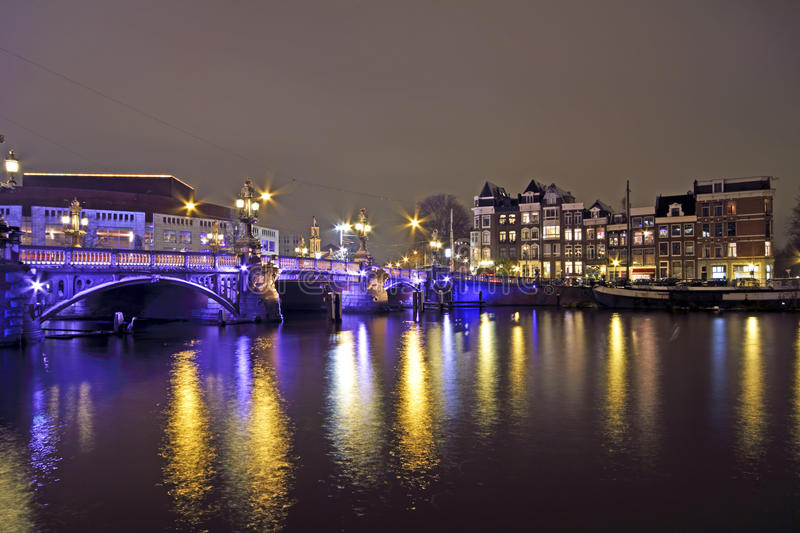 Amsterdam by night with the Blue Bridge at the Amstel in the Net stock photo