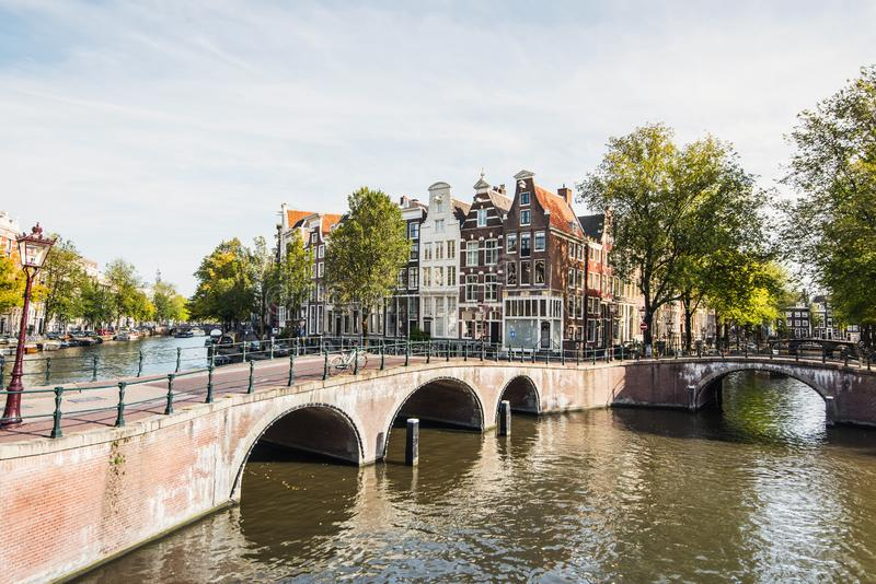 Amsterdam old town, Netherlands, charming street and canals. Popular travel destination and tourist attraction. Amsterdam old town, Netherlands, beautiful street royalty free stock image