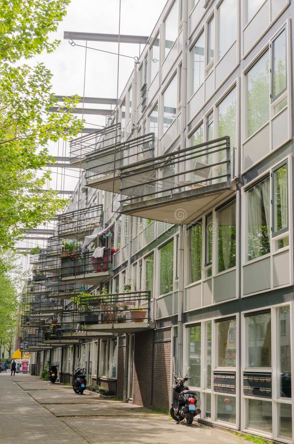 Amsterdam Oost. East side neighbourhoods. View of house facade with unusual triangle balconies hunging on the metal beams. Modern. Architecture. Vertical frame royalty free stock photography