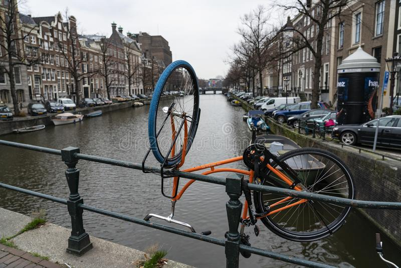 Amsterdam an orange bike upside down along the canals. Amsterdam Holland Amsterdam Holland The city of Amsterdam, capital of the Netherlands, is built on a stock photo