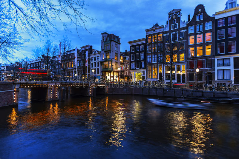 Amsterdam's canal at night stock images