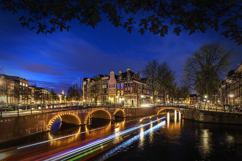 Amsterdam`s canal at night stock image