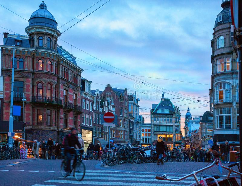 Amsterdam`s city life near the Singel canal view from Koningsplein bridge in the dusk, Netherlands stock images