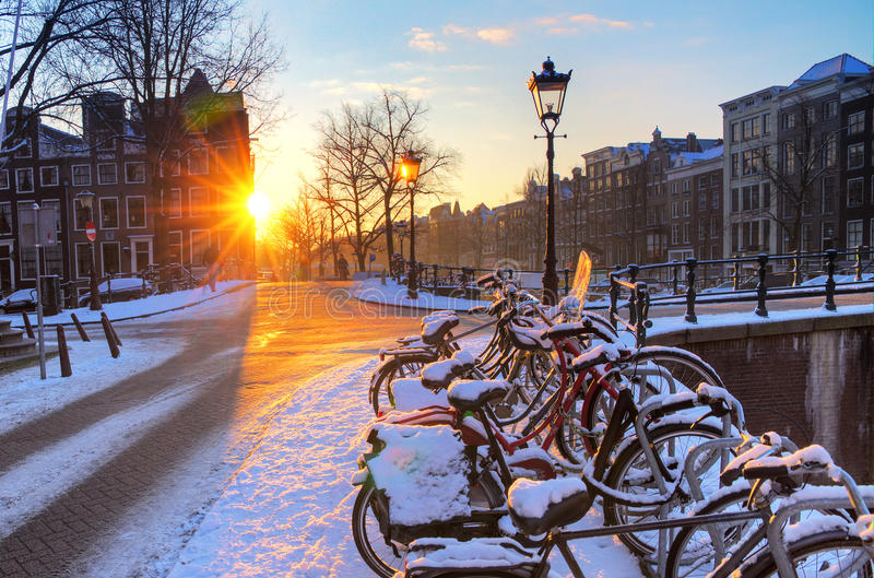 Amsterdam snow sunrise stock photo