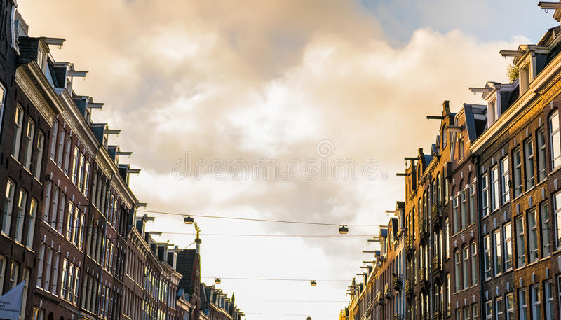 Amsterdam street with housefronts. Big Amsterdam street with rows of houses on each side royalty free stock photo