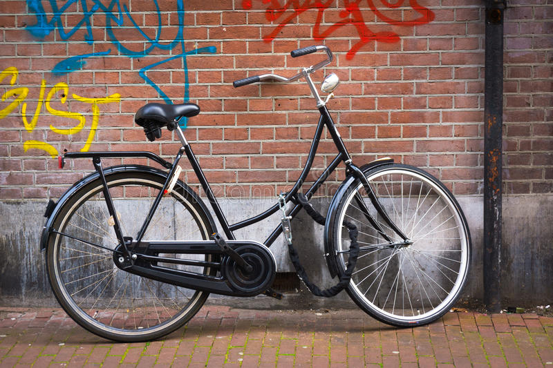 Amsterdam. Traditional dutch bicycle parked on near brick wall in Amsterdam royalty free stock photo