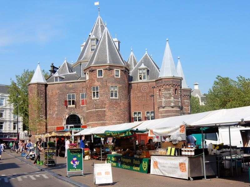 Amsterdam, The Waag monument, Nieuwmarkt square, food market. Amsterdam monumental center, The Waag weigh house, 15th-century building on Nieuwmarkt square with royalty free stock images
