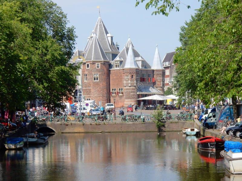 Amsterdam, The Waag monument, Nieuwmarkt square from Kloveniersburgwal. Amsterdam monumental center, The Waag weigh house, 15th-century building on Nieuwmarkt royalty free stock photos