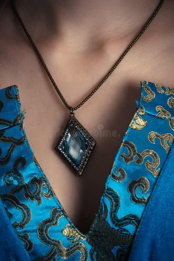 Amuleto em um pescoço fotos de stock