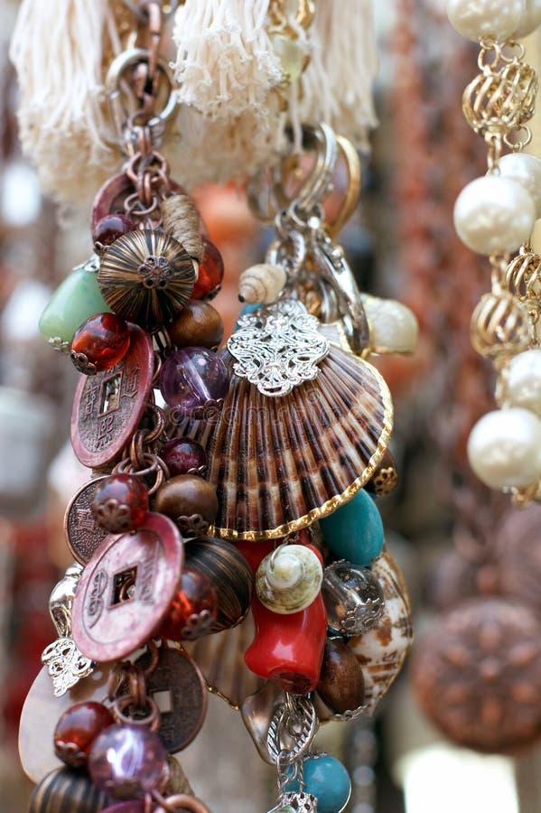 amuletter som hänger juvlar, blir grund royaltyfria bilder