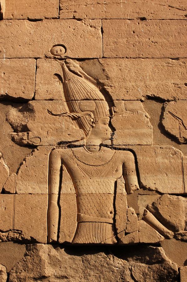 Amun. Carving of the Ancient Egyptian God Amun, wearing the horns of the goat god Khnum. Wall of the Temple of Kalabsha on Lake Nasser, near Aswan, Egypt stock images