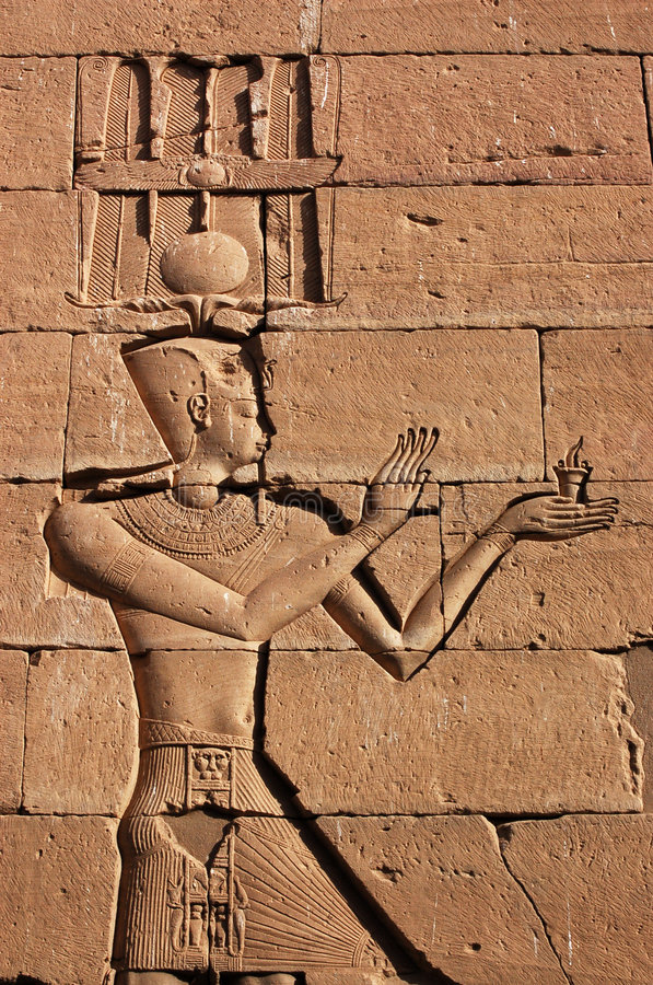Amun carving. A carving of the ancient egyptian god Amun on a wall of the Temple of Kalabsha in Lake Nasser, near Aswan, Egypt royalty free stock photo