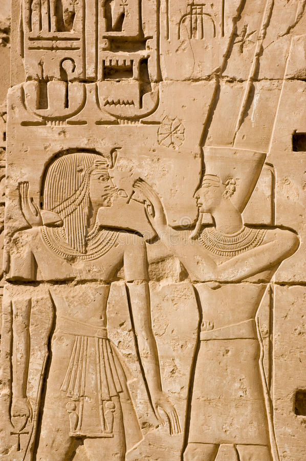 Amun Ra and Ramses II Ancient Carving. An Ancient Egyptian hieroglyphic carving of the King God Amun Ra with the Pharoah Ramses II. Amun is holding the ankh key royalty free stock photography