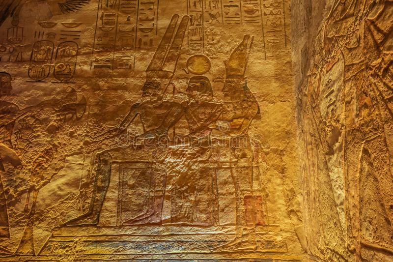 Amun, Ramesses and Nefertari sitting together. In the Great Temple of Abu Simbel stock photo