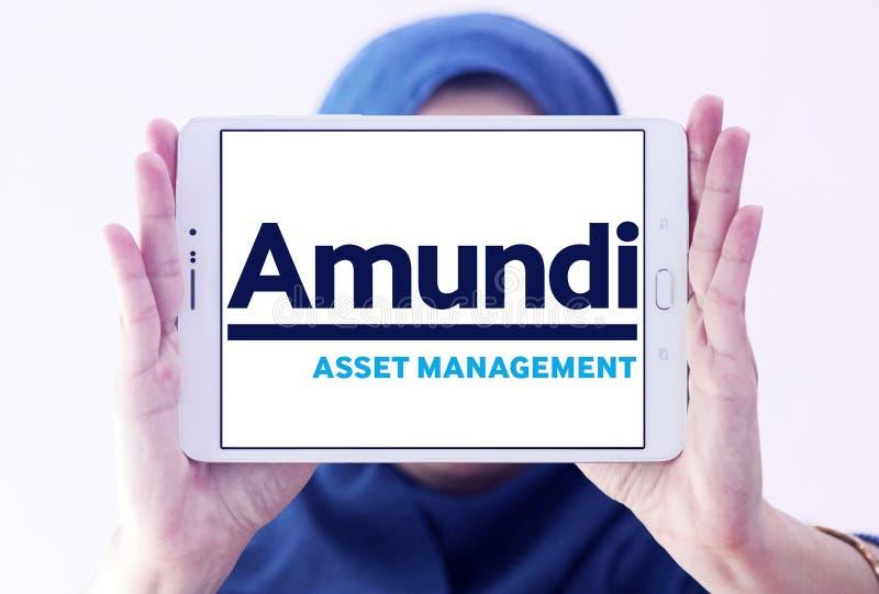Amundi asset management company logo. Logo of Amundi asset management company on samsung tablet holded by arab muslim woman royalty free stock images