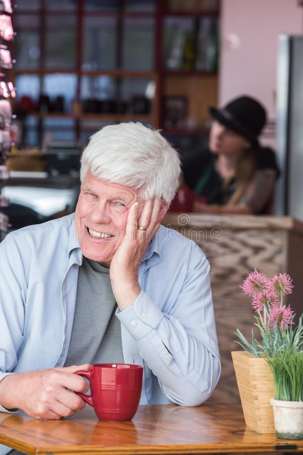 Amused Mature Man in Coffee House stock photography