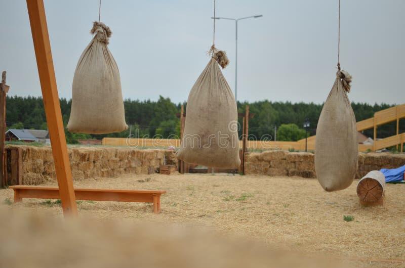 Amusement antique avec des sacs de paille photographie stock libre de droits