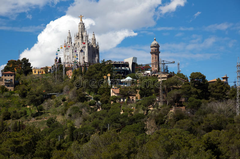 Amusement Park and Church at Tibidabo in Barcelona, Spain. View to Amusement Park on top of Tibidabo and Expiatory Church of the Sacred Heart of Jesus in stock photography