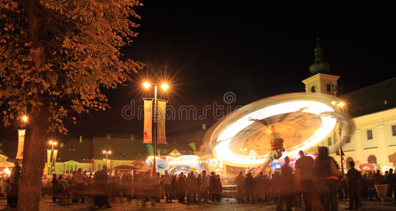 Amusement park in Large Square, Sibiu, Romania. Sibiu, Romania - September 28, 2012: Amusement park and corresponding wheels installed in the Large Square stock photos