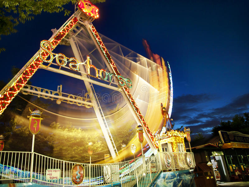 Amusement park at night stock image