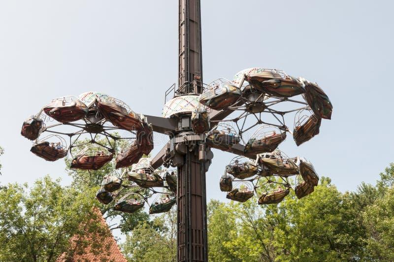 Amusement park ride. A fast Spinning amusement park ride climbing stock images