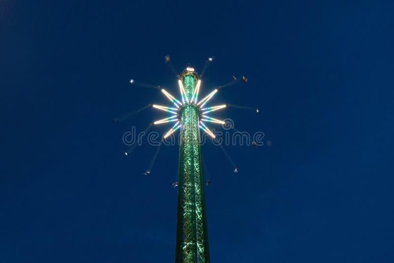 Amusement park ride at night. Theme park, carousel stock photos