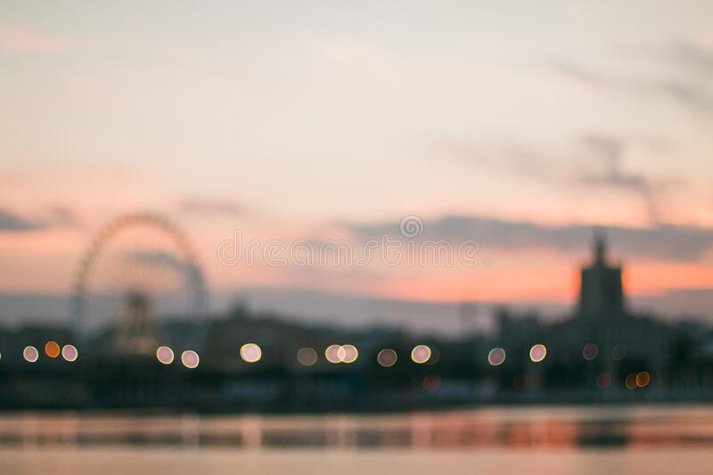 Amusement park at sunset royalty free stock photo